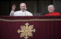 Pope Francis Cardinal Agostino Vallini waves to faithfuls at the , from the balcony of the Rome's Saint John Lateran basilica,  on April 7, 2013.
