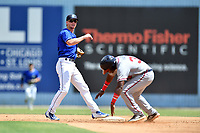 Asheville Tourists second baseman Taylor Snyder (28) makes the turn on a double play over Trey Harris (37) during a game against the Rome Braves at McCormick Field on September 3, 2018 in Asheville, North Carolina. The Tourists defeated the Braves 5-4. (Tony Farlow/Four Seam Images)