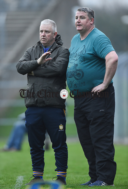 Clare mentors Maurice Walsh and Brendan Rouine on the sideline against  Limerick during their Munster Minor football quarter final at  Cusack Park. Photograph by John Kelly.