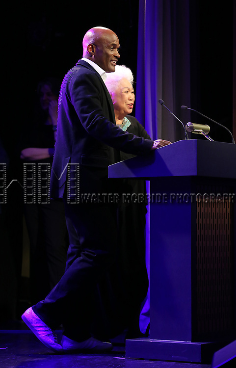 Kenny Leon and Joy Abbott  on stage at the Stage Directors and Choreographers Foundation event honoring Julie Taymor with the Mr. Abbott Award at the Bohemian National Hall on April 2, 2018 in New York City.