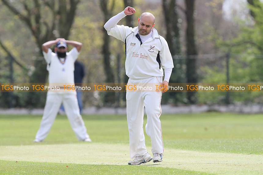 Frustration for Upminster bowler Sarwar - Wanstead CC (batting) vs Upminster CC - Club Cricket Friendly Match at Overton Drive - 22/04/12 - MANDATORY CREDIT: Gavin Ellis/TGSPHOTO - Self billing applies where appropriate - 0845 094 6026 - contact@tgsphoto.co.uk - NO UNPAID USE.