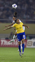 Brazil forward (10) Marta and USA defender (15) Kate Markgraf go up for a header. Brazil (BRA) defeated the United States (USA) 4-0 during the FIFA Women's World Cup China 2007 at Hangzhou Dragon Stadium in Hangzhou, China, on September 27, 2007. Brazil advances to the finals, while the United States will play in the third place game on September 30th.