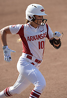 NWA Democrat-Gazette/ANDY SHUPE<br /> Arkansas second baseman Haydi Bugarin heads to first Friday, May 18, 2018, after hitting an RBI single during the third inning to score Carley Haizlip at Bogle Park during the NCAA Fayetteville Softball Regional on the university campus in Fayetteville. Visit nwadg.com/photos to see more photographs from the game.