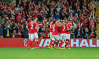 Joe Allen of Wales (second right) is mobbed after scoring his side's second goal during the FIFA World Cup Qualifier match between Wales and Moldova at Cardiff City Stadium, Cardiff, Wales on 5 September 2016. Photo by Mark  Hawkins.