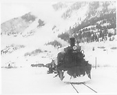 D&amp;RGW #476 head-on near Silverton with a double-headed Silverton Mixed train. A flanger is beween the two engines which are followed by freight cars, passenger cars and a caboose.<br /> D&amp;RGW  Silverton, CO  Taken by Norwood, John B. - 2/1952