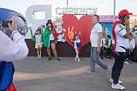"SARANSK, RUSSIA - June 25, 2018: Russia fans pose with a ""I love Saransk"" in Millennium Square in Saransk before the 2018 FIFA World Cup group stage match between Iran and Portugal at Mordovia Arena."