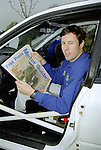 Pix: Shaun Flannery/shaunflanneryphotography.com...COPYRIGHT PICTURE>>SHAUN FLANNERY>01302-570814>>07778315553>>..10th November 1995..Rally driver Colin McRae checks out a copy of the Doncaster Free Press Motor Guide during the recce for the 1995 Network Q RAC Rally at Chatsworth House..Colin went on to win the event and become the first British person and the youngest to win the World Rally Championship Drivers' title.