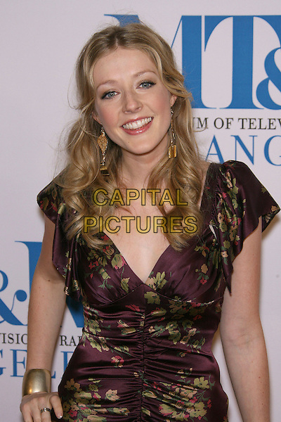 JENNIFER FINNIGAN.The Museum of Television & Radio To Honor Leslie Moonves and Jerry Bruckheimer At its Annual Los Angeles Gala held at Regent Beverly Wilshire Hotel, Beverly Hills, California, USA..October 30th, 2006.Ref: ADM/ZL.half length purple floral print ruched dress gold bracelet .www.capitalpictures.com.sales@capitalpictures.com.©Zach Lipp/AdMedia/Capital Pictures.