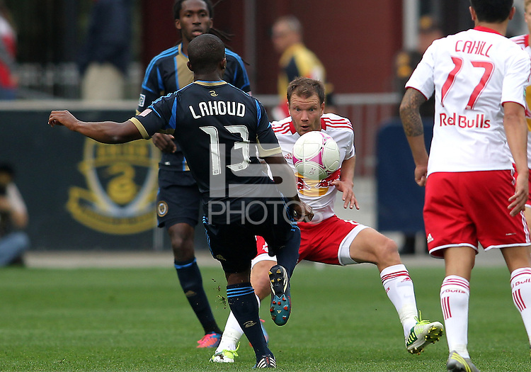 CHESTER, PA - OCTOBER 27, 2012:  Michael Lahoud (13) of the Philadelphia Union kicks the ball towards  Teemu Tainio (6) of the New York Red Bulls during an MLS match at PPL Park in Chester, PA. on October 27. Red Bulls won 3-0.