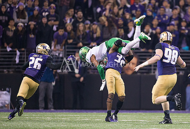Budda Baker upends Darren Carrington.