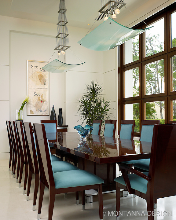 Fabulous dining room with Montanna custom designed light fixtures
