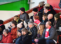 Lincoln City fans watch their team in action<br /> <br /> Photographer Andrew Vaughan/CameraSport<br /> <br /> The EFL Sky Bet League Two - Lincoln City v Port Vale - Tuesday 1st January 2019 - Sincil Bank - Lincoln<br /> <br /> World Copyright &copy; 2019 CameraSport. All rights reserved. 43 Linden Ave. Countesthorpe. Leicester. England. LE8 5PG - Tel: +44 (0) 116 277 4147 - admin@camerasport.com - www.camerasport.com