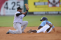Osvaldo Martinez #2 Shortstop Jacksonville Suns (Marlins) makes the tag out on an attempted steal by Tony Campana #24 of the Tennessee Smokies (Cubs) May 20, 2010 Photo By Tony Farlow/Four Seam Images.