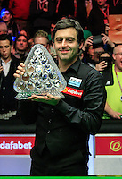 Ronnie O'Sullivan lifts the Dafabet trophy after the Dafabet Masters FINAL between Barry Hawkins and Ronnie O'Sullivan at Alexandra Palace, London, England on 17 January 2016. Photo by Liam Smith / PRiME Media Images