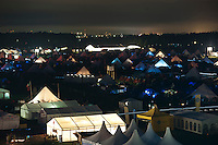 Main Square and parts of Autumn sub camp are nicely lit up in the night. The big white tent in the background is the Jamboree Head Quarters that never sleep. Further in the distance you can see some of the taller houses of Kristianstad, the nearest big (albeit smaller) city. Photo: Eric Hampusgård/Scouterna