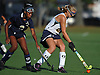 Shannon Bernhardt #21 of Massapequa, right, gets pressured by Kayla Brown #3 of Baldwin during the first half of a Nassau County Conference I varsity field hockey match at Field of Dreams Park in Massapequa on Monday, Sept. 26, 2016. Bernhardt tallied three assists in Massapequa's 5-0 win.