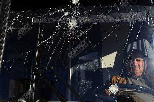 At the central bus station in the South Ossetian capital Tskhinval, a driver sat in his bus whose windscreen still bore the scars of the conflict with Georgia in August 2008. February 13, 2008