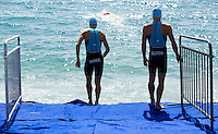 16 SEP 2012 - NICE, FRA - Akos Vanek and Brendan Sexton of TCG 79 Parthenay prepare for a warm up swim before the start of the French Grand Prix triathlon series final stage held during the Triathlon de Nice Côte d'Azur (PHOTO (C) 2012 NIGEL FARROW)