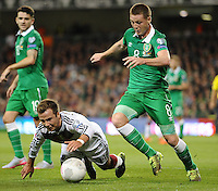 08/10/2015; UEFA Euro 2016 Group D Qualifier - Republic of Ireland v Germany, Aviva Stadium, Dublin. <br /> Germany's Mario Gotze with James McCarthy of Ireland.<br /> Picture credit: Tommy Grealy/actionshots.ie.