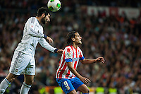 Falcao and Albiol fights an aerial ball