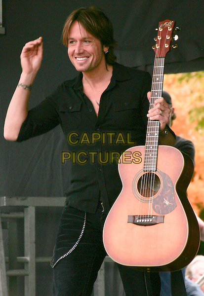 KEITH URBAN.performs a free acoustic set at the Verizon Wireless Store, Cool Springs, Tennessee, USA, .30th October 2009..music concert gig live on stage performing half length guitar black top shirt  hand arm smiling          .CAP/ADM/EM.©Eddie Malone/Admedia/Capital Pictures