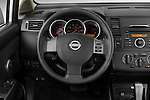 Steering wheel view of a 2009 Nissan Versa Hatchback