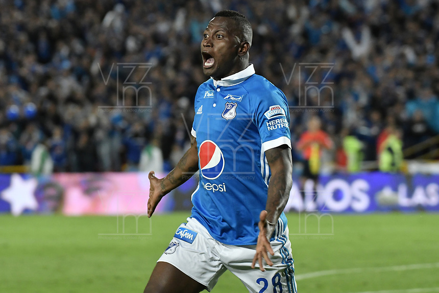 BOGOTA - COLOMBIA -04 -06-2017: Duver Riascos de Millonarios celebra después de anotar el segundo gol  de su equipo a Atlético Bucaramanga durante partido de vuelta por los cuadrangulares finales de la Liga Aguila I 2017 jugado en el estadio Nemesio Camacho El Campin de la ciudad de Bogota. / Duver Riascos of Millonarios celebrates after scoring the second goal of his team to Atletico Bucaramanga during secong leg match for the final quadrangulars of the Liga Aguila I 2017 played at the Nemesio Camacho El Campin Stadium in Bogota city. Photo: VizzorImage / Gabriel Aponte / Staff.