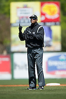 Umpire Jose Navas indicates that there is one out during the South Atlantic League game between the Delmarva Shorebirds and the Kannapolis Intimidators at Kannapolis Intimidators Stadium on April 13, 2016 in Kannapolis, North Carolina.  The Intimidators defeated the Shorebirds 8-7.  (Brian Westerholt/Four Seam Images)
