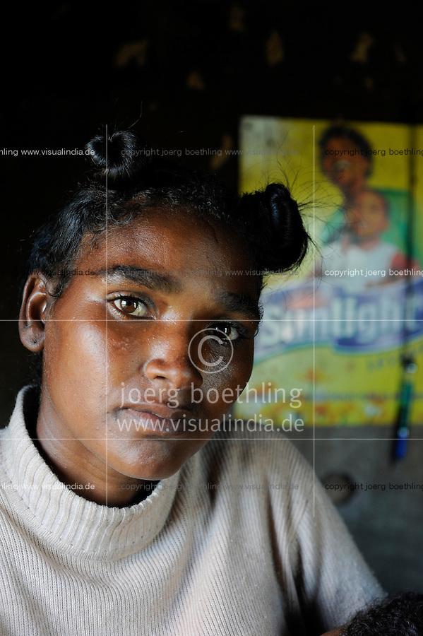 """MADAGASCAR Antananarivo, catholic priest Per Pedro Opeka has build Akamasoa a social community project with housing schemes, health units and schools for the poorest of Tana, woman Séraphine Rafarasoa / MADAGASKAR Pater Pedro Opeka hat die Gemeinde Akamasoa , auf madagassisch """"gute Freunde"""" , mit Muellsammlern, Bettlern und Sozialschwachen auf einem Huegel bei Antananarivo erbaut, Teil des Projektes sind Hausbau, Schulen, Krankenhaeuser und Beschaeftigung, Frau Séraphine Rafarasoa"""
