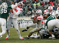 Ohio State Buckeyes running back Mike Weber Jr. (25) scores a touchdown with help from a block by tight end Luke Farrell (89) on Michigan State Spartans defensive lineman Drew Beesley (86) during the fourth quarter of the NCAA football game at Spartan Stadium in East Lansing, Mich. on Nov. 10, 2018. Ohio State won 26-6. [Adam Cairns/Dispatch]