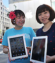 April 28, 2011, Tokyo, Japan - Two Japanese women show off their iPad2 in front of Apple Store in Tokyo Ginza shopping district as the tablet computers go on sale in Japan at long last on Thursday, April 28, 2011. iPad2 was originally set to go on sale on March 25 but was postponed as the country grapples with the earthquake and tsunami devastation. (Photo by Natsuki Sakai/AFLO) [3615] -mis-