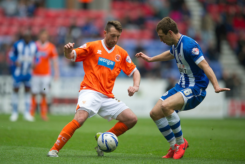 Blackpool's Stephen Dobbie and Wigan Athletic's James McArthur<br /> <br /> Photo by Stephen White/CameraSport<br /> <br /> Football - The Football League Sky Bet Championship - Wigan Athletic v Blackpool - Saturday 26th April 2014 - DW stadium - Wigan<br /> <br /> &copy; CameraSport - 43 Linden Ave. Countesthorpe. Leicester. England. LE8 5PG - Tel: +44 (0) 116 277 4147 - admin@camerasport.com - www.camerasport.com