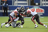24 September 2011:  FIU wide receiver Glenn Coleman (10) is tackled by ULL cornerback Melvin White (22) and defensive end Bernard Smith (44) in the second quarter as the University of Louisiana-Lafayette Ragin Cajuns defeated the FIU Golden Panthers, 36-31, at FIU Stadium in Miami, Florida.