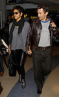 Halle Berry and Olivier Martinez hold hands at the LAX airport - Los Angeles