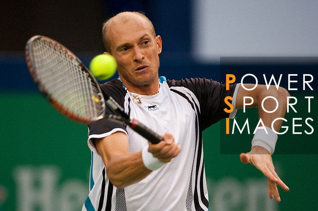 SHANGHAI, CHINA - OCTOBER 17:  Nikolay Davydenko of Russia returns a shot to Novak Djokovic of Serbia on their semi final match during day seven of 2009 Shanghai ATP Masters 1000 at Qi Zhong Tennis Centre on October 17, 2009 in Shanghai, China. Photo by Victor Fraile / The Power of Sport Images