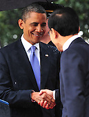 United States President Barack Obama and President Lee Myung-bak of South Korea shake hands during an arrival ceremony on the South Lawn of the White House in Washington, D.C. on Thursday, October 13, 2011.  .Credit: Kevin Dietsch / Pool via CNP