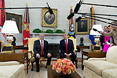 US President Donald J. Trump (R) and Prime Minister of Israel Benjamin Netanyahu (L) deliver remarks to members of the news media during their meeting in the Oval Office of the White House in Washington, DC, USA, 25 March 2019. Trump earlier signed an order recognizing Golan Heights as Israeli territory.<br /> Credit: Michael Reynolds / Pool via CNP