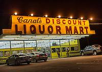 Discount liquor store at night.