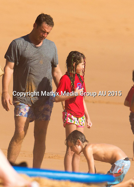 24 JANUARY 2015 SYDNEY AUSTRALIA<br /> <br /> EXCLUSIVE PICTURES<br /> <br /> Karl Stefanovic pictured with his wife Cassandra and kids Jackson, Ava and River swimming and having fun at Palm Beach. <br /> <br /> *No internet without clearance*.MUST CALL PRIOR TO USE +61 2 9211-1088. Matrix Media Group.Note: All editorial images subject to the following: For editorial use only. Additional clearance required for commercial, wireless, internet or promotional use.Images may not be altered or modified. Matrix Media Group makes no representations or warranties regarding names, trademarks or logos appearing in the images.
