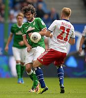 FUSSBALL   1. BUNDESLIGA   SAISON 2013/2014   6. SPIELTAG Hamburger SV - SV Werder Bremen                       21.09.2013 Santiago Garcia (SV Werder Bremen) gegen Maximilian Beister (re, Hamburger SV)