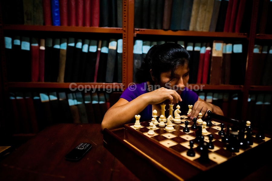 A blind girl plays chess in the library of Unión Nacional de Ciegos del Perú, a social club for the visually impaired in Lima, Peru, 6 April 2013. Unión Nacional de Ciegos del Perú, one of the first societies for disabled in Latin America, was established in 1931 to provide a daily service for blind and partially sighted people from the capital city. The range of activities includes reading books in a large Braille library, playing chess or using a computer adapted for visually impaired individuals. As the majority of the blind does not have a regular job, the UNCP club offers them an opportunity to learn and lately, to provide massages to the club visitors and thus generate some income.