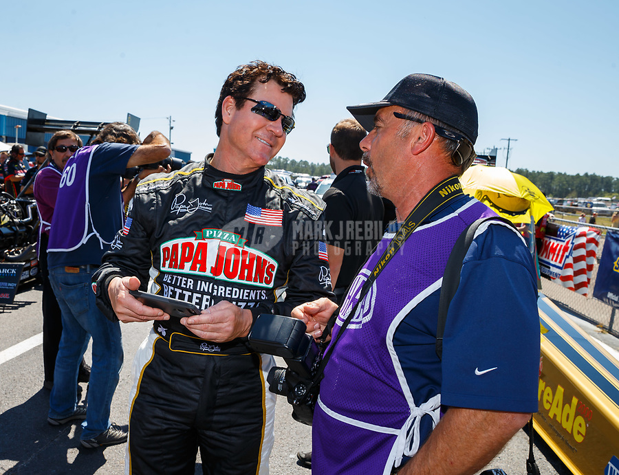 Mar 18, 2017; Gainesville , FL, USA; Papa Johns Pizza founder John Schnatter (left) talks with photographer Gary Nastase during qualifying for the NHRA Gatornationals at Gainesville Raceway. Mandatory Credit: Mark J. Rebilas-USA TODAY Sports
