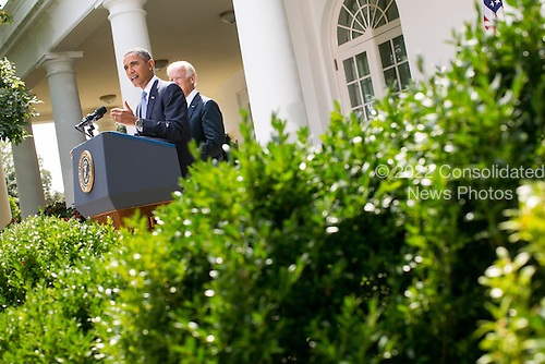 United States President Barack Obama, joined by Vice President Joe Biden, delivers a statement on Syria in the Rose Garden of the White House in Washington, D.C. on August 31, 2013. <br /> Credit: Kristoffer Tripplaar  / Pool via CNP