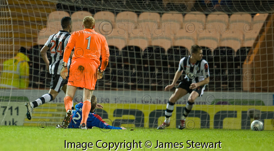 CALEY'S BILLY MCKAY GETS THE BETTER OF ST MIRREN'S CRAIG SAMSON BUT ONLY MANGES TO SCOOP THE BALL PAST THE POST..03/12/2011   Copyright  Pic : James Stewart.sct_jsp011_st_mirren_v_ict  .James Stewart Photography 19 Carronlea Drive, Falkirk. FK2 8DN      Vat Reg No. 607 6932 25.Telephone      : +44 (0)1324 570291 .Mobile              : +44 (0)7721 416997.E-mail  :  jim@jspa.co.uk.If you require further information then contact Jim Stewart on any of the numbers above.........