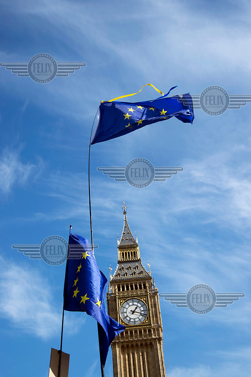 EU flags and the Clock Tower of the Houses of Parliament during a 'Unite for Europe March on Parliament'.