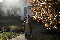 NWA Democrat-Gazette/CHARLIE KAIJO Julia Stilwell, 10, sings while caroling during the Washco Historical Society annual Holiday Open House, Sunday, December 2, 2018 at the Headquarters House in Fayetteville.<br /><br />Visitors enjoyed treats and drinks and carolers sang for neighbors of the Headquarters House.