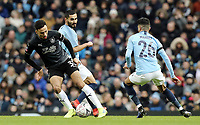 Burnley's Dwight McNeil under pressure from Manchester City's Ilkay Gundogan and Riyad Mahrez<br /> <br /> Photographer Rich Linley/CameraSport<br /> <br /> Emirates FA Cup Fourth Round - Manchester City v Burnley - Saturday 26th January 2019 - The Etihad - Manchester<br />  <br /> World Copyright © 2019 CameraSport. All rights reserved. 43 Linden Ave. Countesthorpe. Leicester. England. LE8 5PG - Tel: +44 (0) 116 277 4147 - admin@camerasport.com - www.camerasport.com