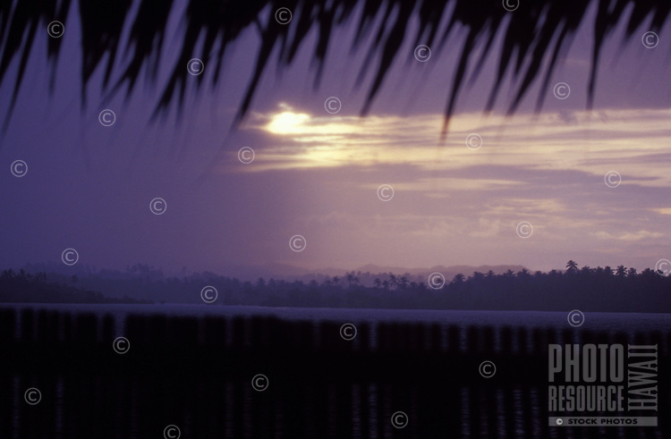 Sunset seen from thatched hut on the ocean, Siargao Island, Philippines
