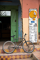 Rissani, Morocco.  Bicycle outside Entrance to a Small Restaurant.