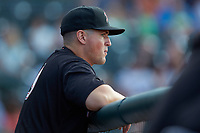 Kannapolis Intimidators manager Justin Jirschele (9) watches the action from the dugout during the game against the Hickory Crawdads at L.P. Frans Stadium on July 20, 2018 in Hickory, North Carolina. The Crawdads defeated the Intimidators 4-1. (Brian Westerholt/Four Seam Images)